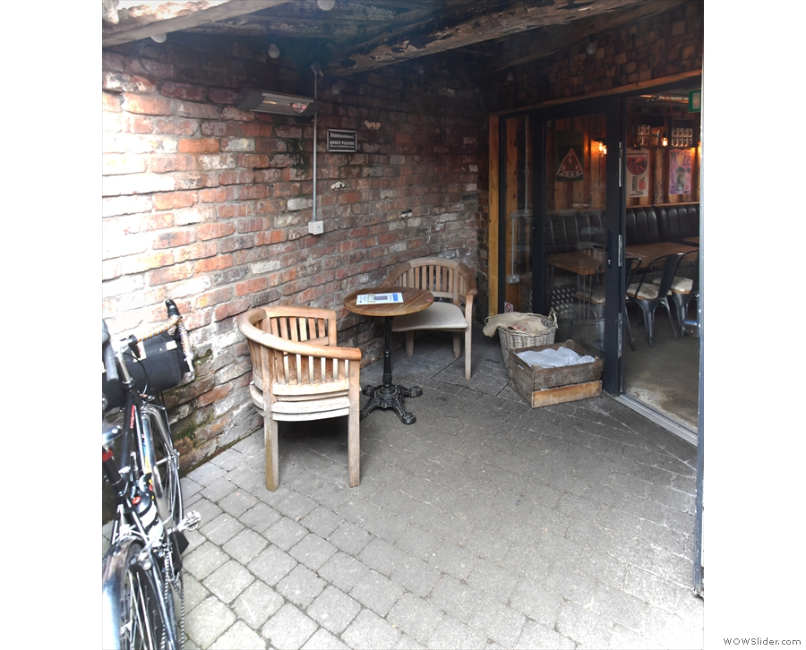 ... where you'll find bike parking spaces and this neat, two-person table.