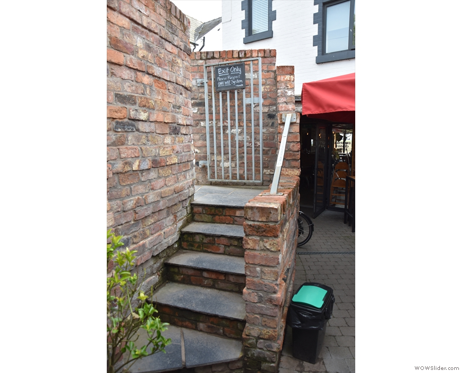 The steps are, for now, exit only, but normally you can enter this way through the garden.