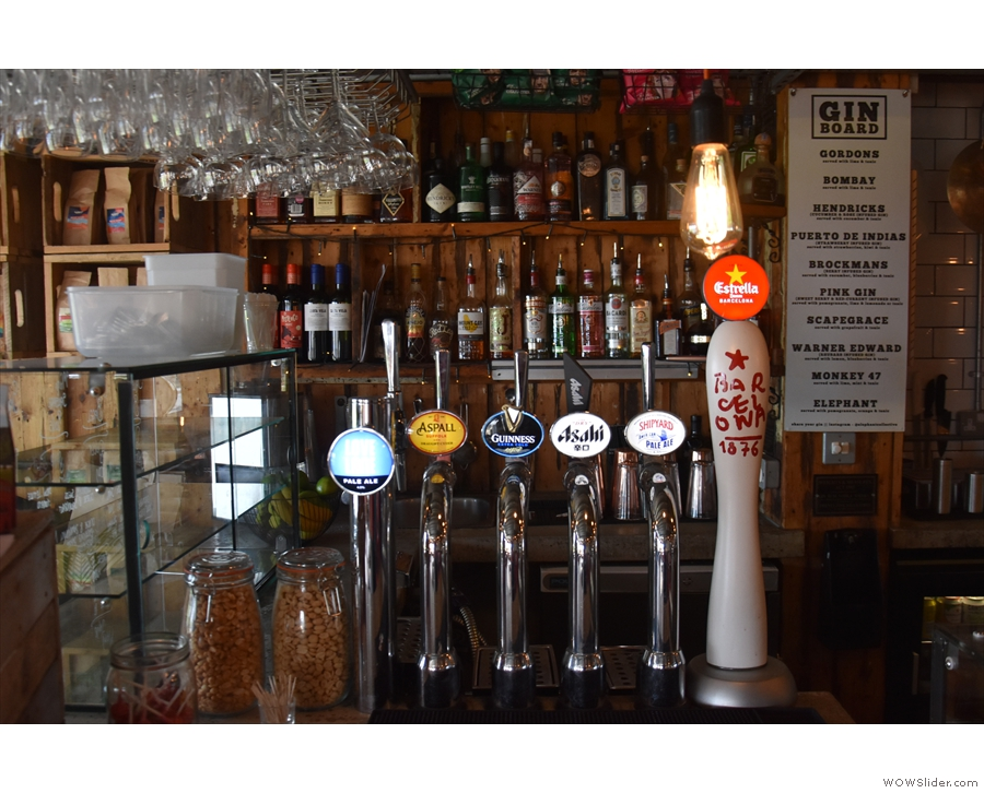 There's a selection of beer on tap, with spirits on the shelves behind...