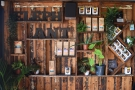 ... Elephant Lounge rather gives away its coffee roots with these retail shelves...