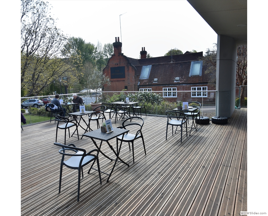 ... the back of the spacious terrace, where you are welcome to sit once you've ordered.