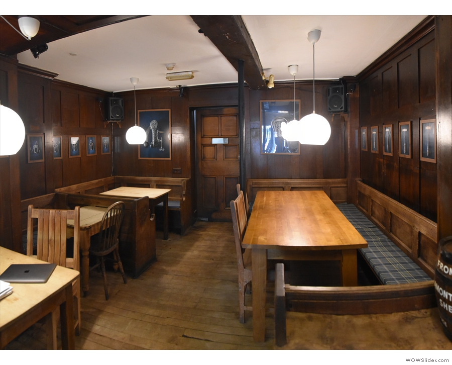 ... to yet another seating area, with four more tables (and a door to the kitchen).