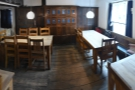 ... leads to a second space with another four tables.