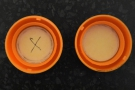 Identical, that is, apart from a mark on the inside of the lids.