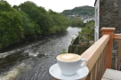 I'll leave you with a shot of my flat white, enjoying the view down the river.