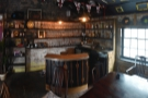 ... at the front, where you'll also find a well-stocked bar.