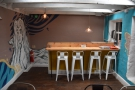 The four-person bar overlooks a flight of stairs...