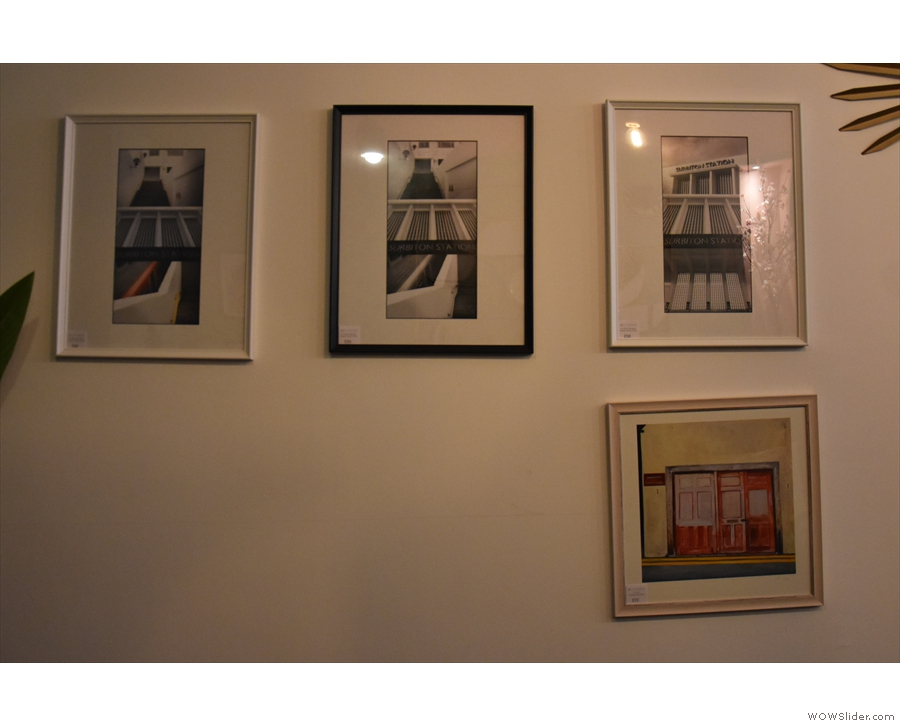 ... while the wall opposite has a display of photography from jokheirdesign.com.
