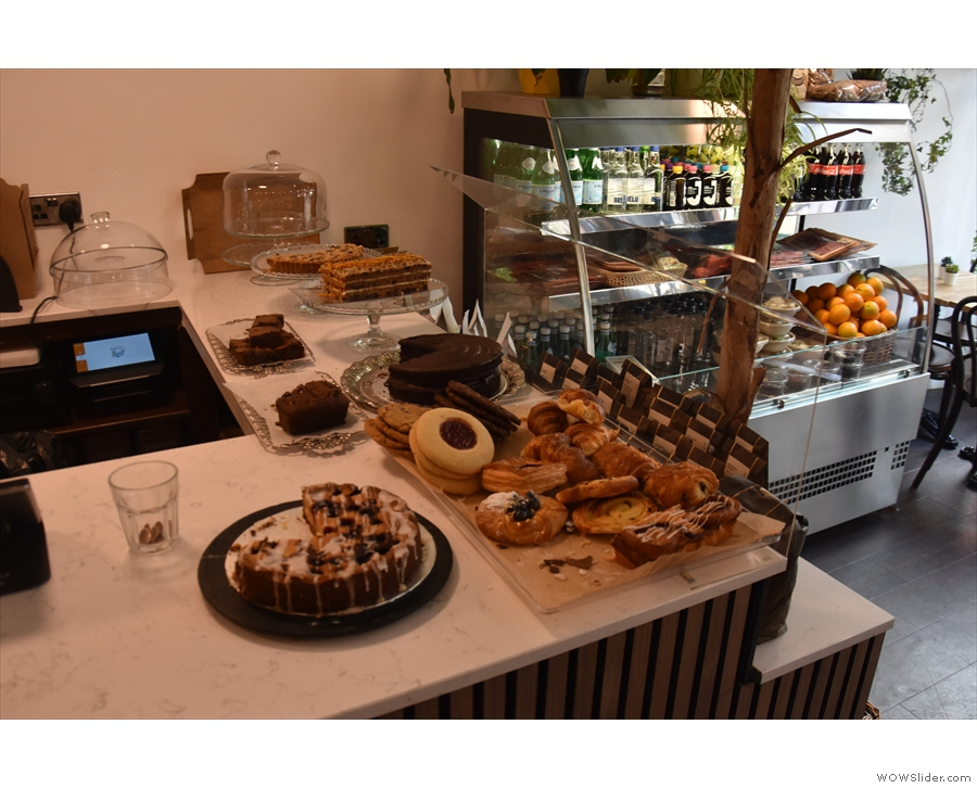 The cakes are displayed at the front of the counter...