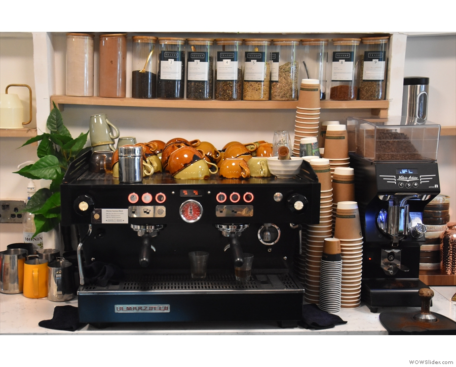 The La Marzocco espresso machine and its Mythos One grinder is at the back...