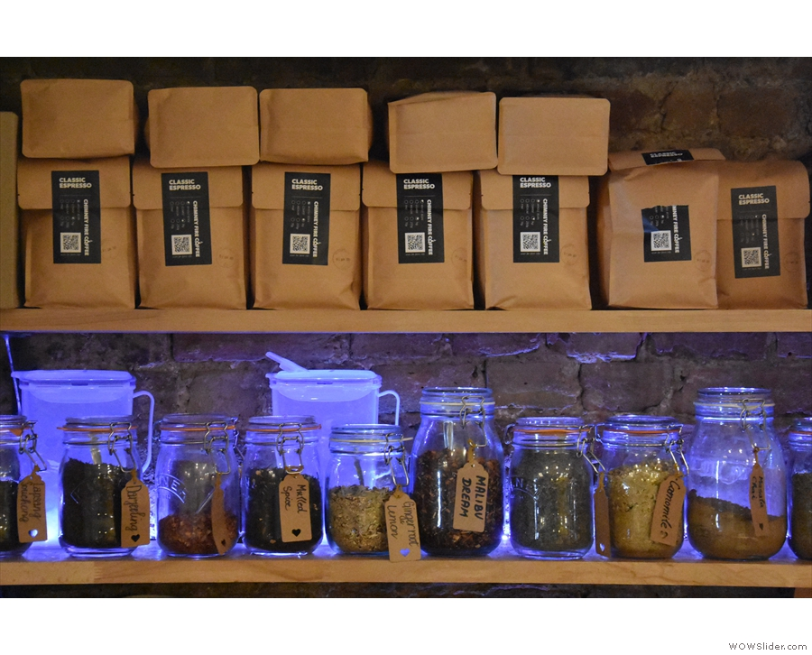 ... machine tucked away in the corner, bags of Chimney Fire Coffee on the shelves.