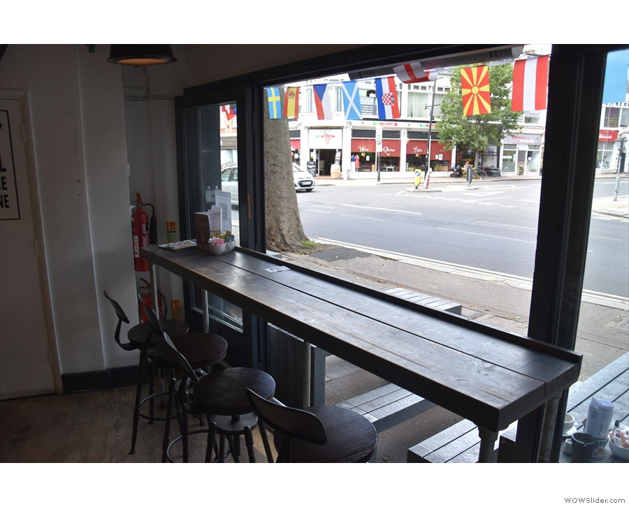 There's plenty of seating in here, starting with this four-person window bar to the right.