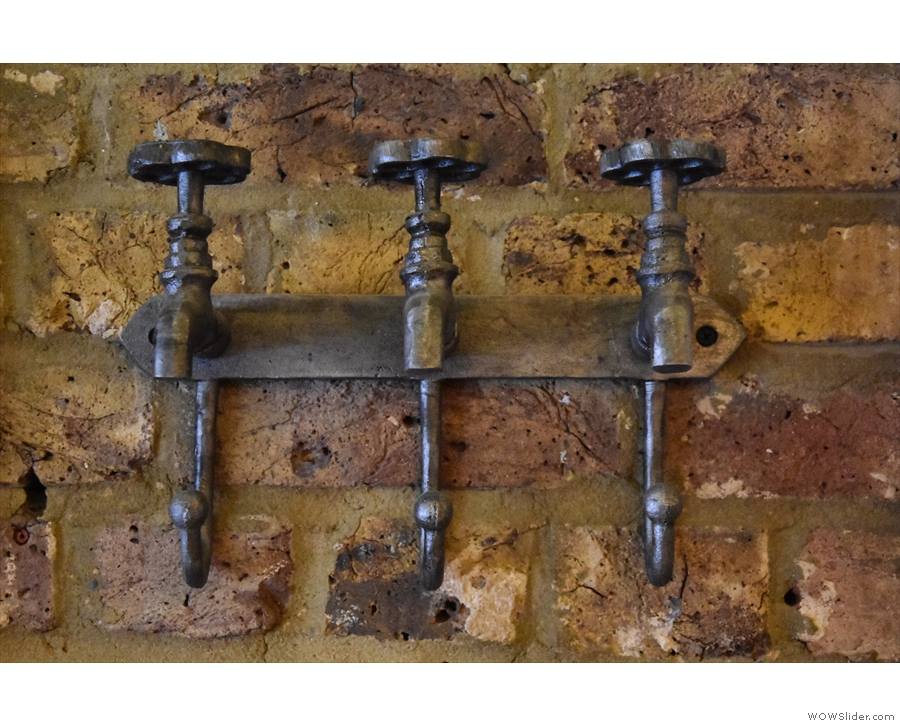 ... these old taps, which have been repurposed as coat hooks.