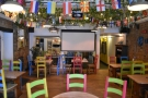 There are more tables at the back, where you'll find the big screen for watching sports.
