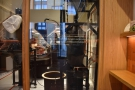 At the back, beyond the glass wall, is the roastery...
