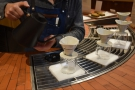 There are four Kinto drippers at the front the counter, each on its own scales. Step one...