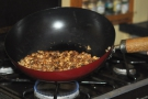 At its simplest, you can use a wok to roast coffee like I'm doing here at home.