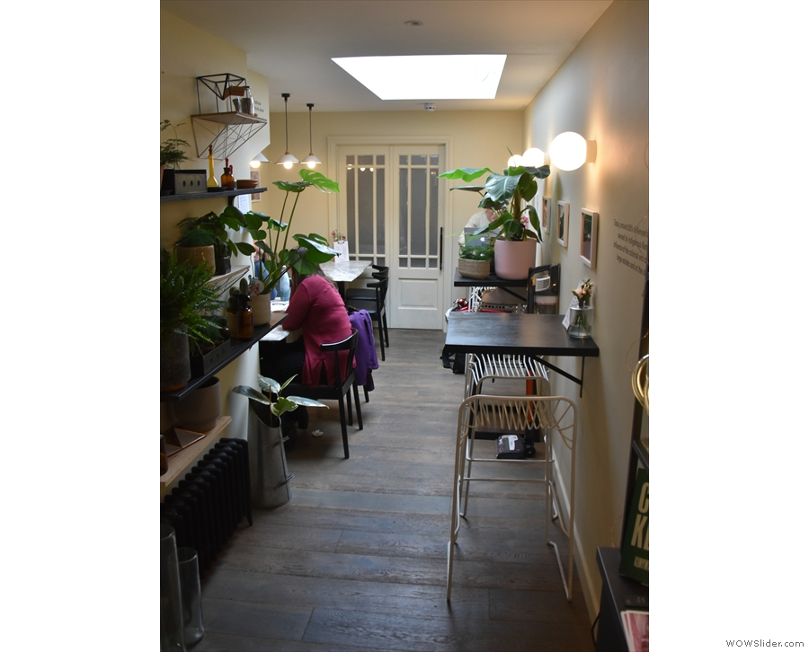 ... where you'll find a cosy sitting room, lit by a skylight in the middle of the ceiling.