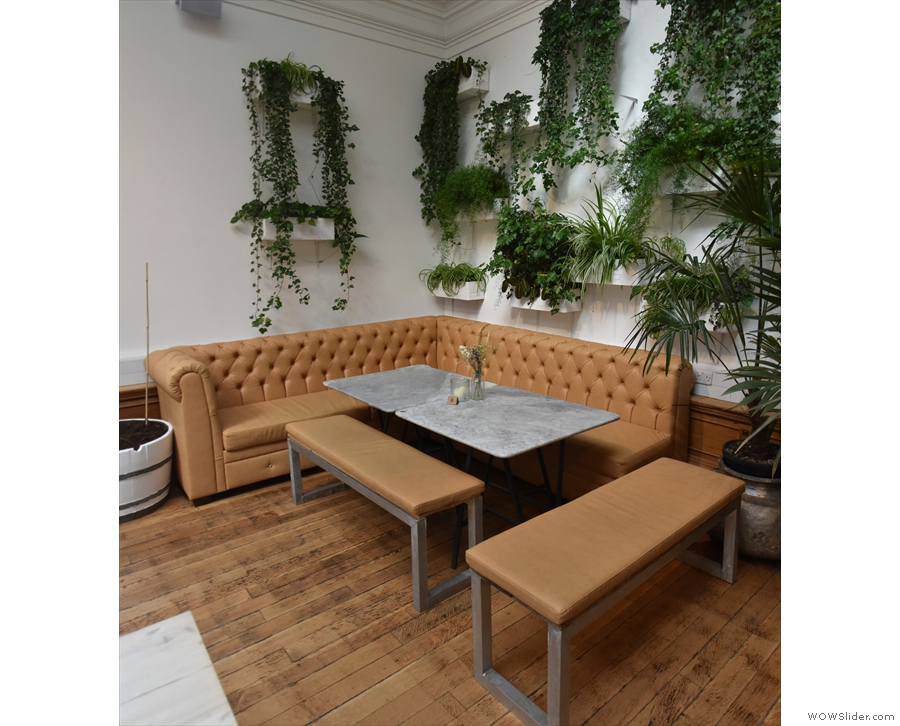Beyond the fire escape, this sofa and its benches occupy the far left-hand corner...