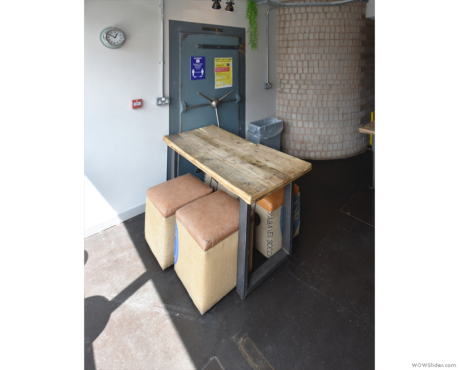... and this four-person table against the door to the safe on the left-hand side.