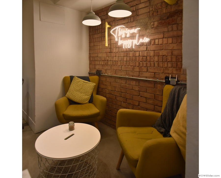 Finally, in a shallow nook in the front wall, there's a pair of armchairs.