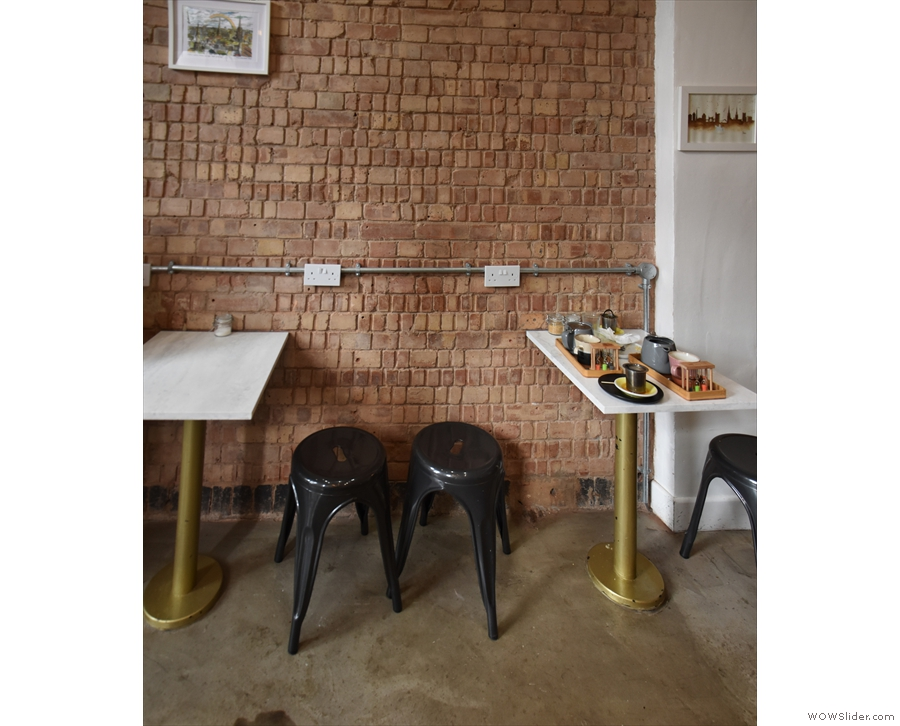 The only other seating is this pair of two-person tables against the left-hand wall...