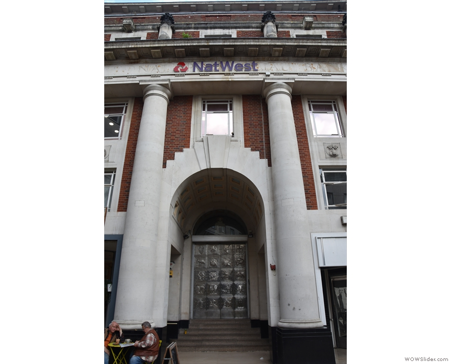 Behold, the might arch and metal doors of Natwest (the table belongs to Bean & Leaf).