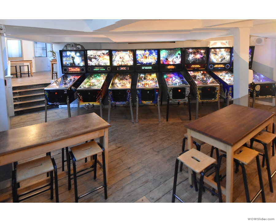 A view of the pinball machines from beyond the tables. But what's that off to the left?