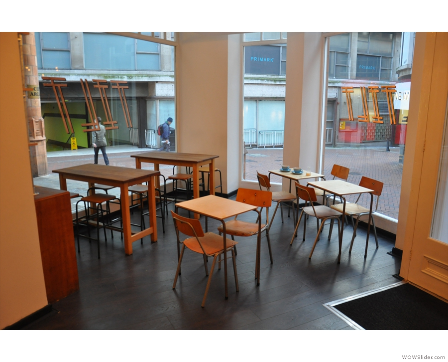 The basic layout is the same. In 2016, there were five tables to the right of the door...