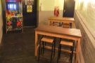 ... although now it has a couple of tables. The left-hand of the two doors leads to the...