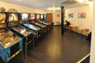 Going past the counter, you come to the pinball part of Tilt, which stretches off to the left.