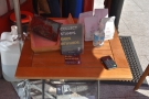 ... and there's a small table out front for the retail bags and card reader.