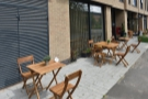 The tables extend a long way down the pavement, far beyond the front of the cafe.