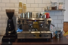 The espresso machine, meanwhile, is at the front end of the counter to the right...