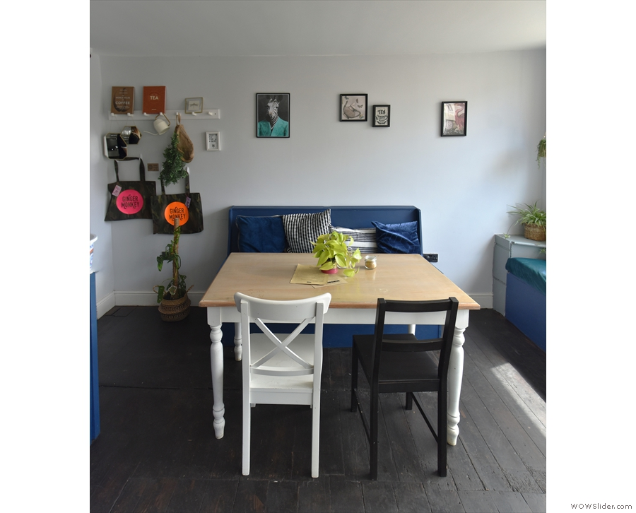 The four-person table seen front on.