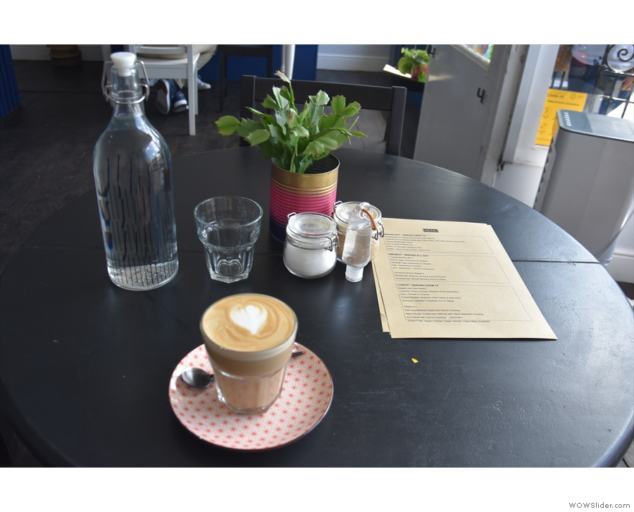 I had a flat white, served in a glass. You'll find food menus on the tables, by the way.