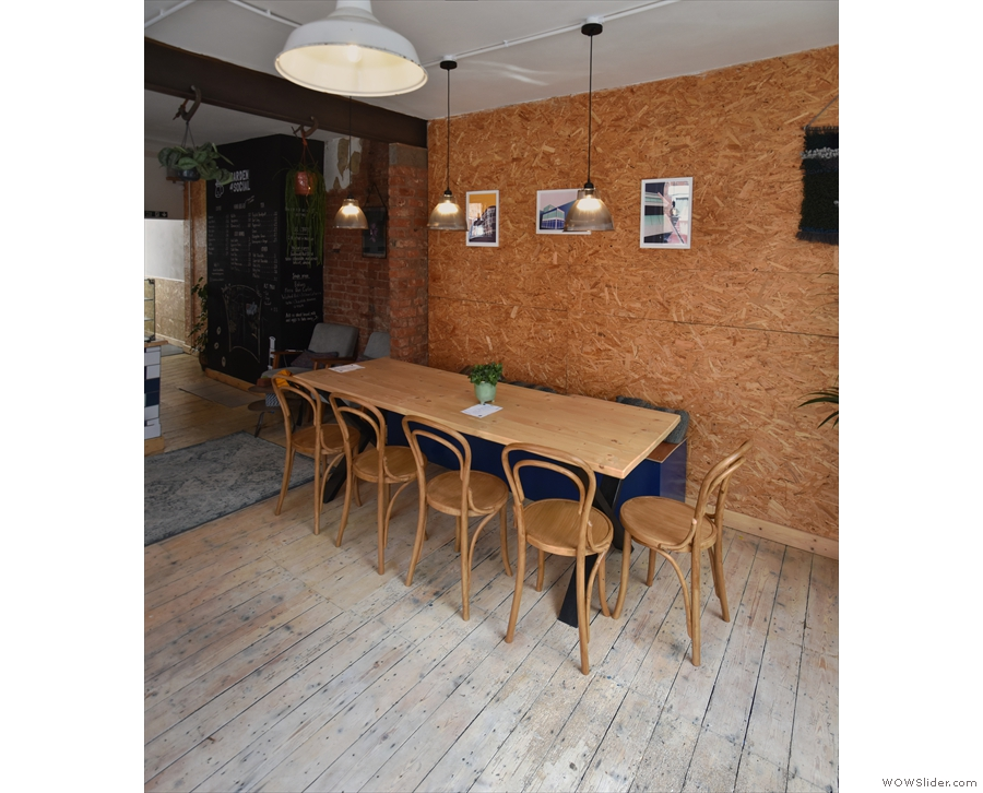 Finally, directly opposite the door, is this nine-person table, and that's it for the front part.