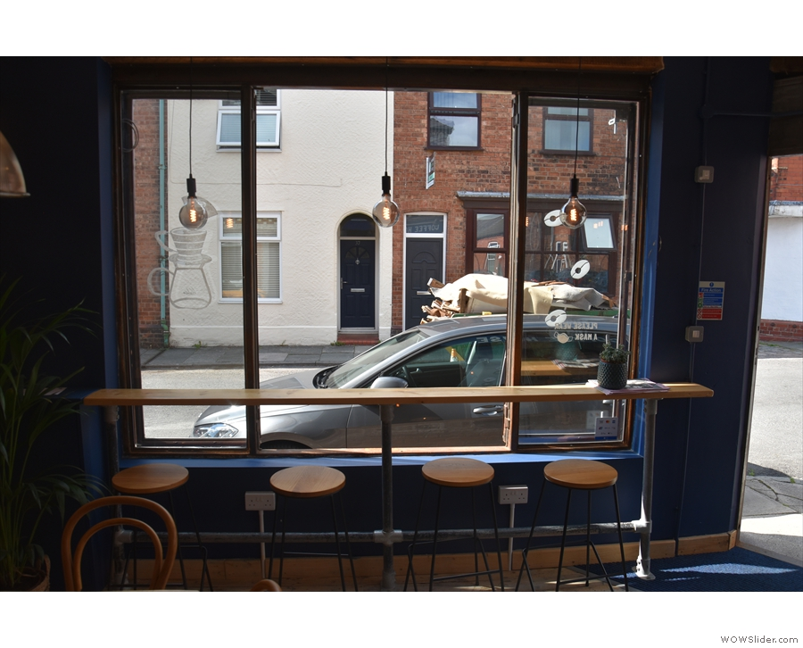 There's a four-person window-bar on the right, looking out onto Catherine Street...