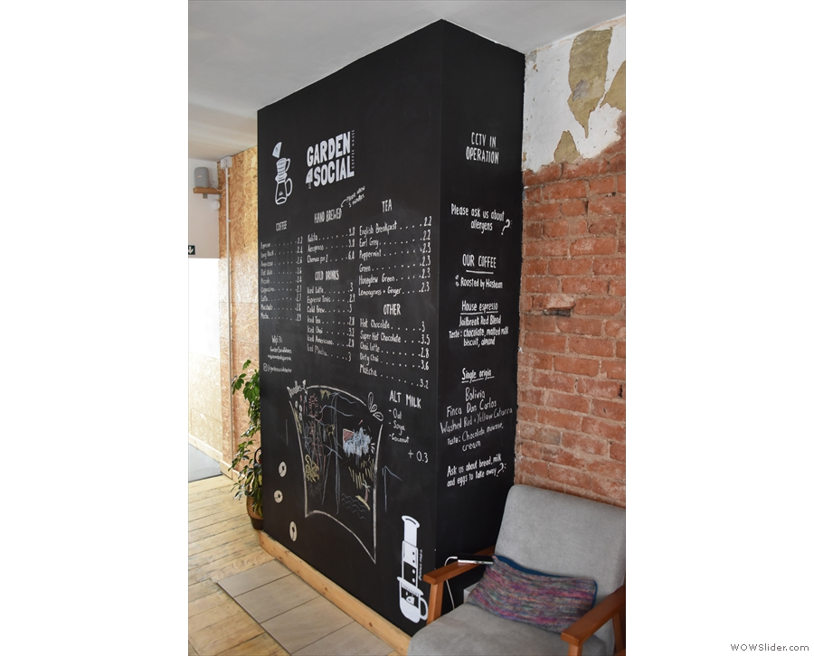You'll find the drinks menu on the boarded up chimney to the right of the counter...