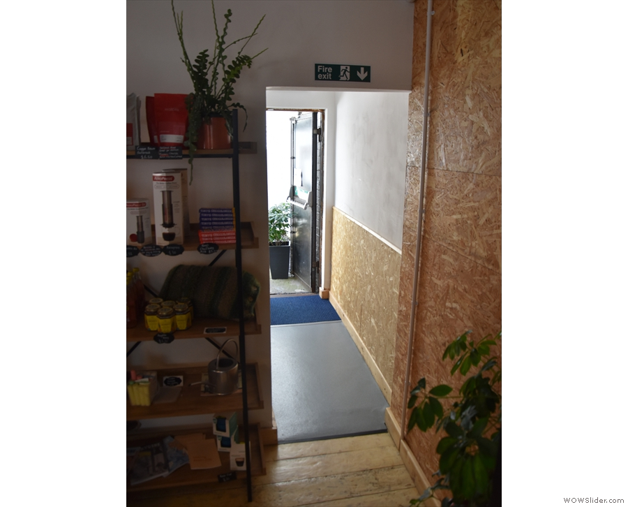 ... at the back, on the right-hand side, an open doorway leads to a short corridor...