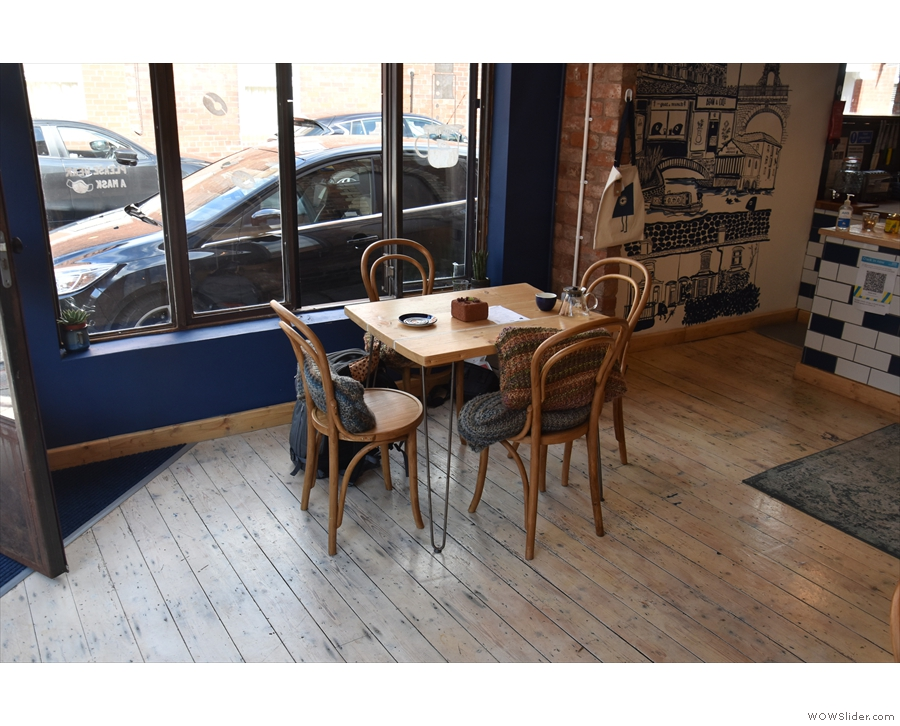 ... while the window onto Charlotte Street has a solitary four-person table.