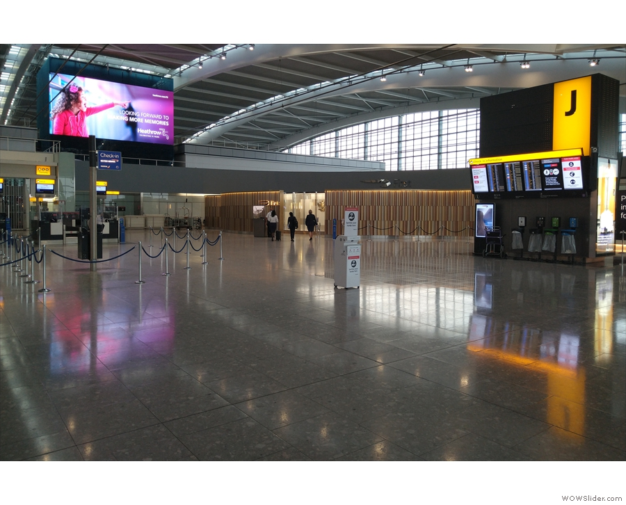 ... emerging directly opposite the First Class check-in area.
