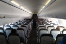 ... while here's the corresponding in-flight view, the curtains between us and Club Europe.