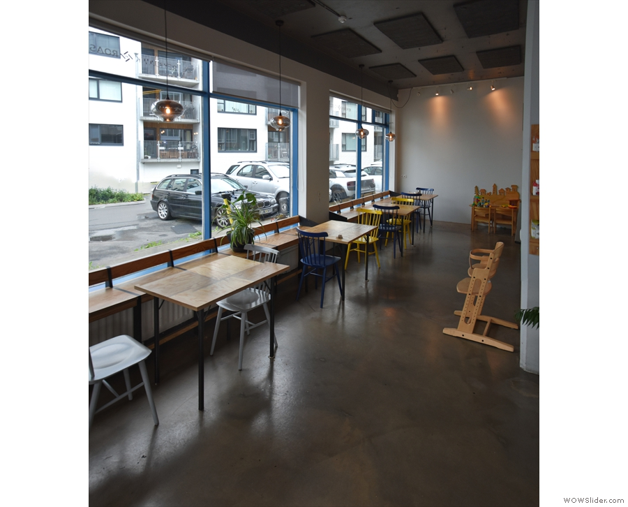 ... with two tables per window, each with a pair of chairs.