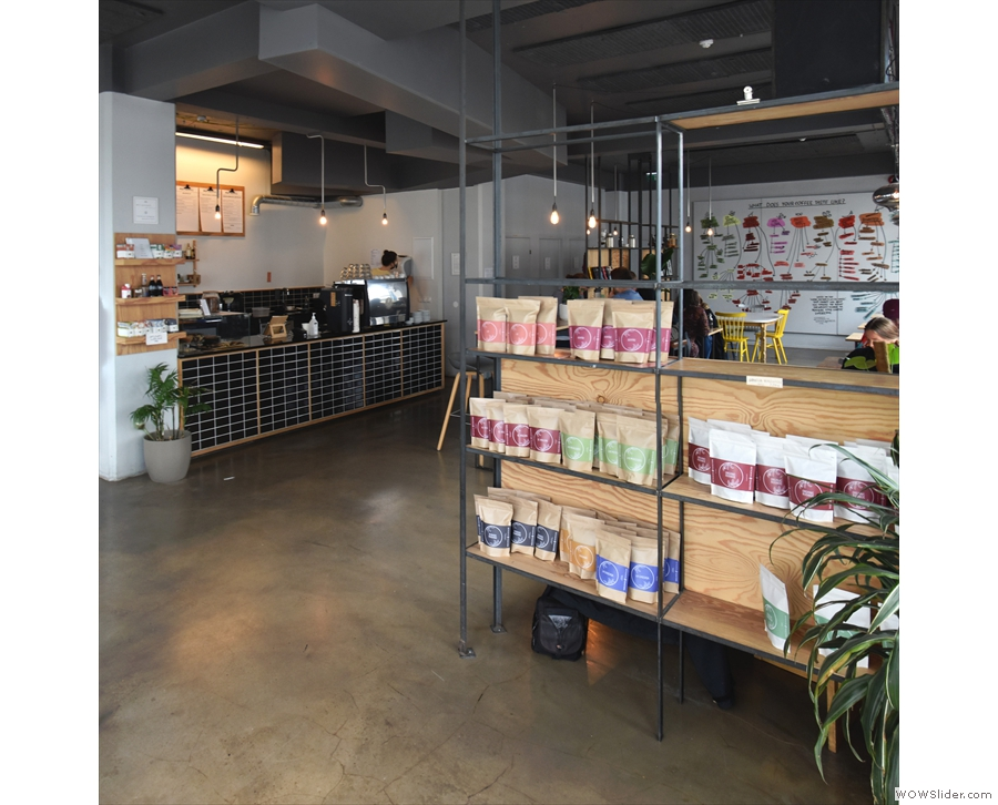 The internal entrance porch is formed by retail shelves for coffee (straight ahead)...