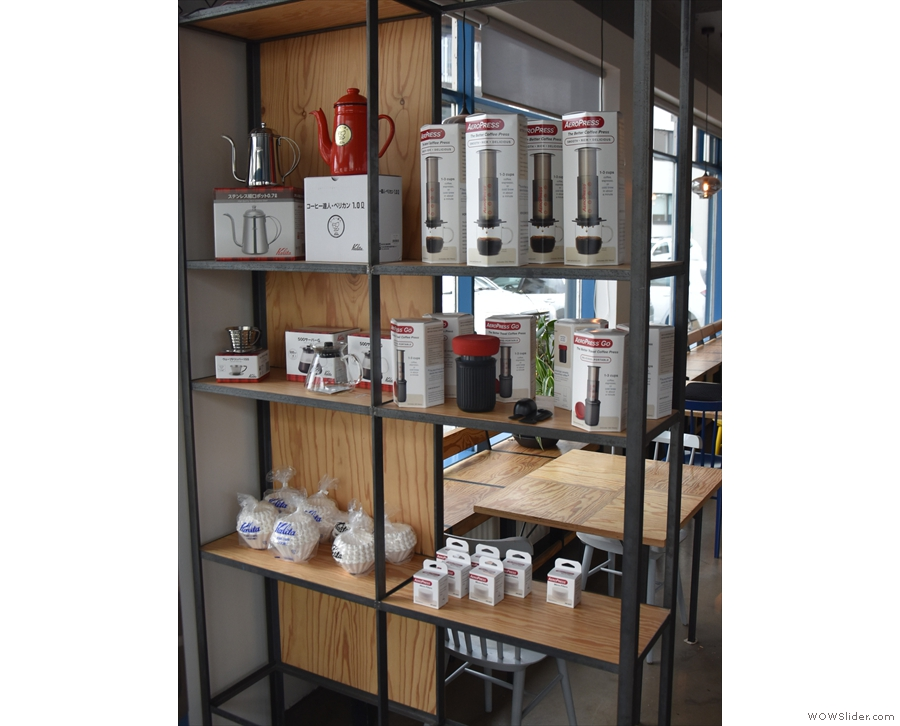 ... and, to your left, coffee eqipement. The seating is split, starting behind the shelf...