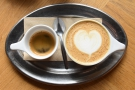 ... single-shot cappuccino, nicely presented on a tray.