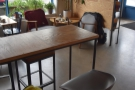 ... a two-person table, then this tall, eight-person table opposite the counter.