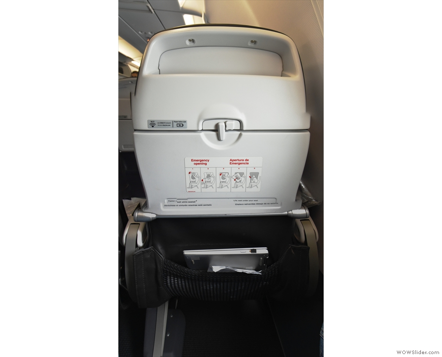 A lot of my seat's facilities were in the back of the seat in front. There's stowage for my...
