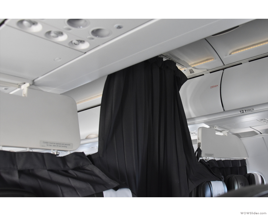 Five minutes after take-off, the curtains were drawn and the seat belt signs came off.